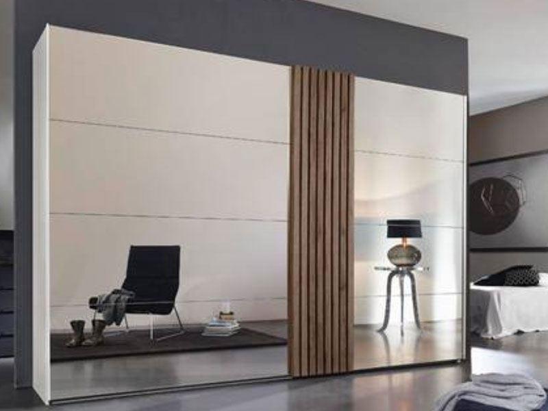 rauch tegio schwebet renschrank mit spiegel und vertikaler absetzung. Black Bedroom Furniture Sets. Home Design Ideas